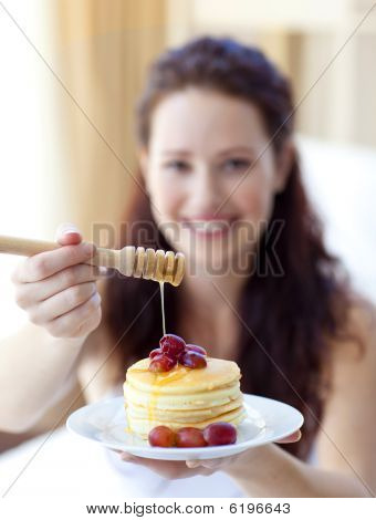 Woman Holding Pancakes With Fruit And Honey