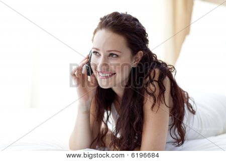 Beautiful Woman Lying In Bed Talking On Phone