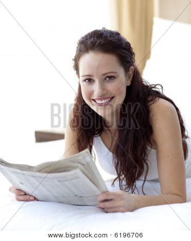 Beautiful Woman In Bed Reading A Newspaper