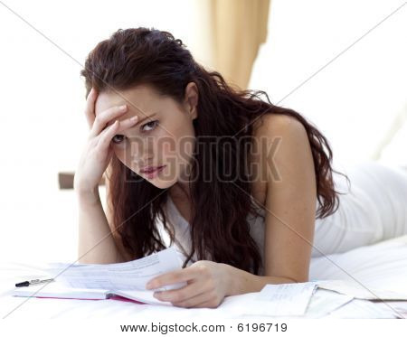 Beautiful Woman In Bed Getting Frustrated With Bills