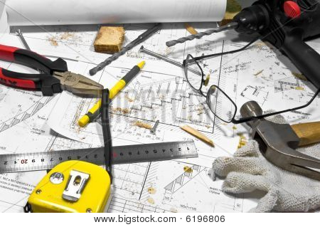 Different Tools And Blueprints Are Lying On Carpenter Workbench,
