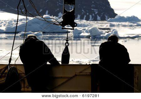 Workers On Vessel In Antarctica