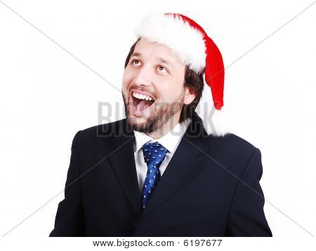 Young Male Model In Suit With Santa Hat On Head