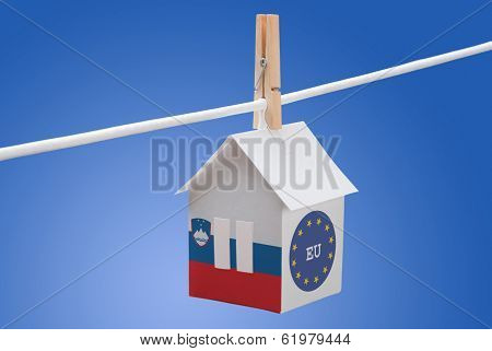 Slovenia, Slovenian and EU flag on paper house