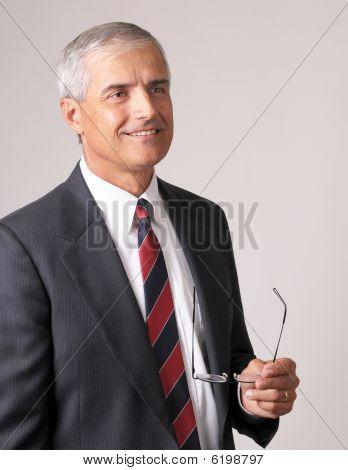 Profile Portrait of a Smiling Middle Aged Businessman