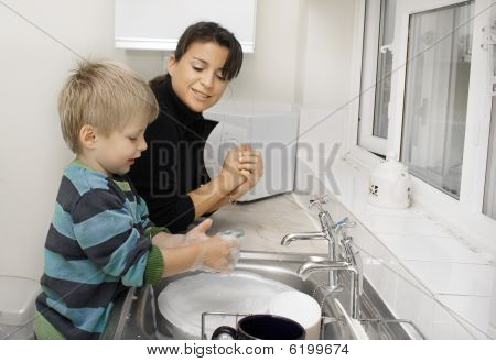 Mother and son washing up