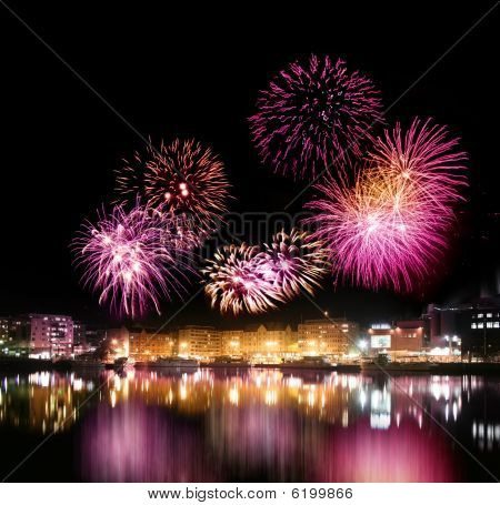 Fireworks Over City By The Water