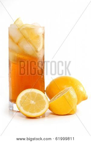 Glass of lemon cold iced tea with lemons on white background