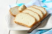 stock photo of sorghum  - Fresh from the oven sliced gluten free bread on plate - JPG