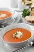 picture of lobster tail  - Two bowls of lobster bisque garnished with slice of lobster tail cream and fresh tarragon - JPG