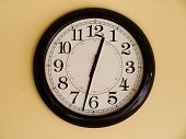 stock photo of clocks  - Close up of Big brown clock on yellow wall - JPG