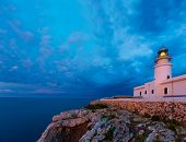 foto of faro  - Menorca sunset in Faro Far de Caballeria Lighthouse at Balearic Islands es Mercadal - JPG