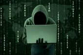 stock photo of hack  - Hacker typing on a laptop with binary code background - JPG