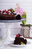 pic of tort  - Vegan chocolate cake with berries and coconut on top - JPG