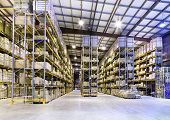 stock photo of warehouse  - Interior of new large and modern warehouse space - JPG