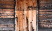 image of hasp  - Wooden wall with doors locked - JPG