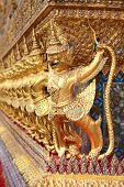 stock photo of garuda  - row of garuda in Pra Keaw temple - JPG