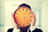 foto of running-late  - Businesswoman with clock - JPG
