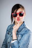 foto of pouting  - Asia woman pout lip with sunglasses - JPG