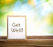 pic of get well soon  - Get well message card over shiny leaves background - JPG