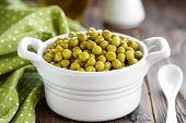 pic of green pea  - Green canned peas  in a bowl on a table - JPG