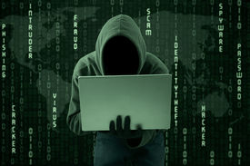 stock photo of spyware  - Hacker typing on a laptop with binary code background - JPG