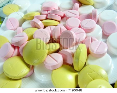 White And Colored Drug Pills In Blisters