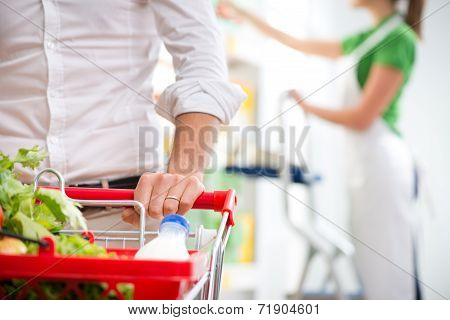 Customer At Supermarket Hands Close-up