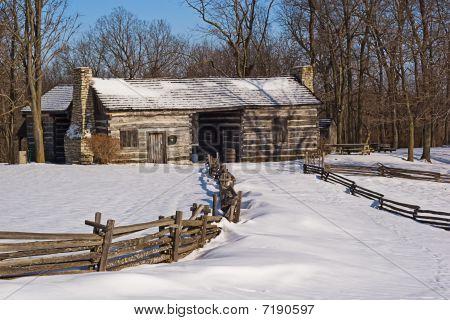 Snowy Log Cabin At Sunrise
