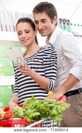 Couple Shopping At Supermarket