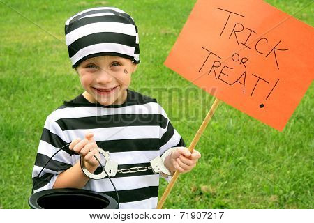Young Child Dressed In Halloween Costume Trick-or-treating