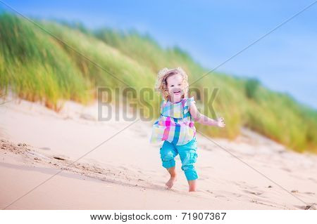 Little Girl Runnign In Sand Dunes