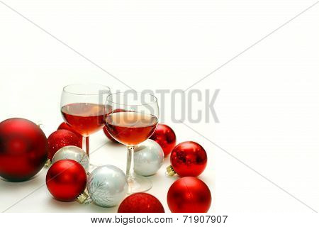 Two Wine Glasses Surrounded By Christmas Decorations