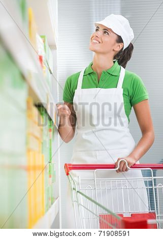 Supermarket Worker With Cart
