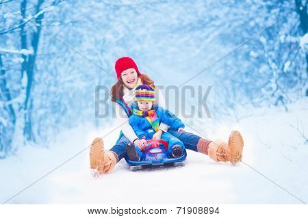 Mother And Baby Enjoying A Sleigh Ride