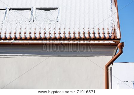 Snow On Tiled Rooftop