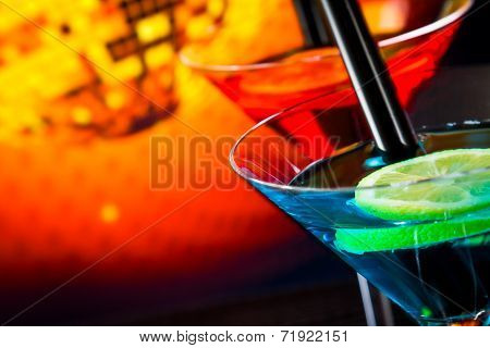Top Of View Of Cocktail On Sparkling Disco Ball Background With Space For Text