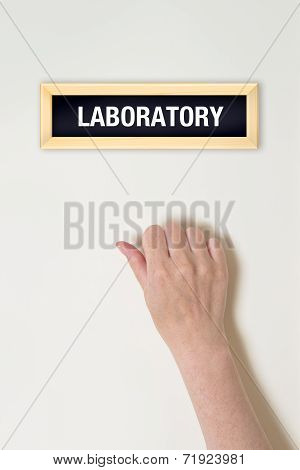 Female Hand Is Knocking On Laboratory Door