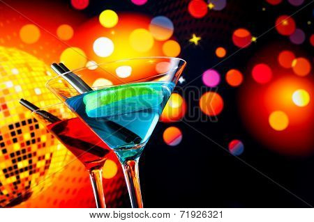 Blue And Red Cocktail With Sparkling Disco Ball Background With Space For Text