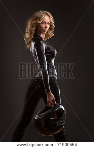 Beautiful and sexy biker woman with helmet