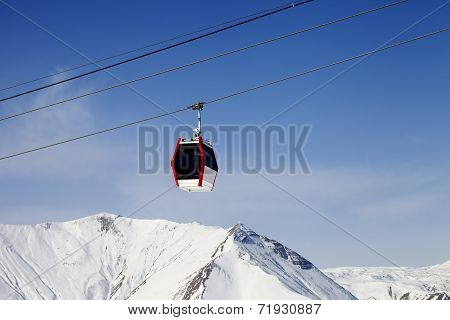 Gondola Lift And Snowy Mountains