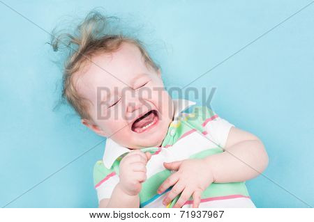 Sweet Crying Baby On A Blue Blanket