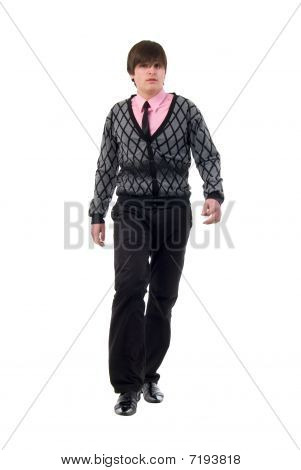 Walking Young Man. Studio Shoot Over White Background.
