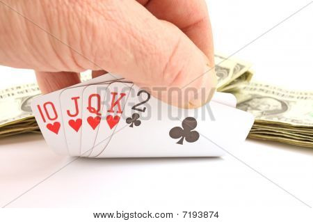 Man's hand holding gambling cards