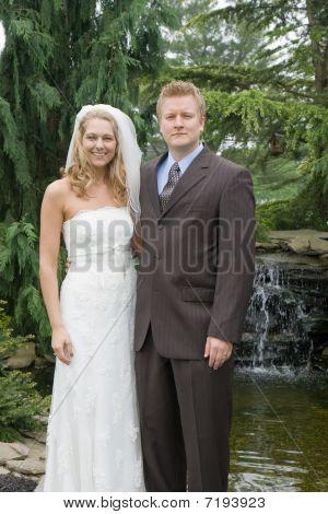 Bride & Groom Portrait in front of waterfall