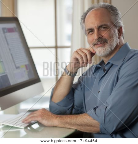 Businessman Sitting In Front Of Computer