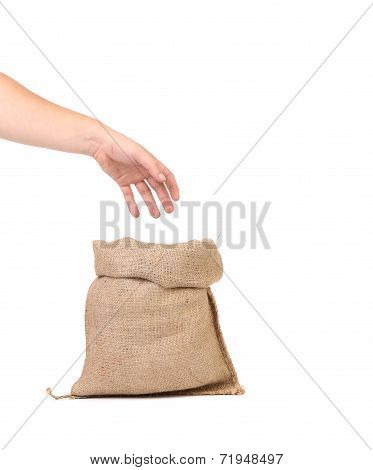 Hand holds bag with euro banknotes.