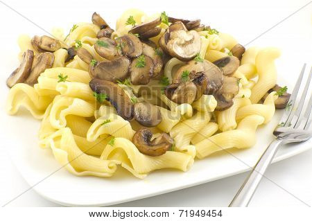 Gigli Con Funghi pasta dish with chopped parsley leaves