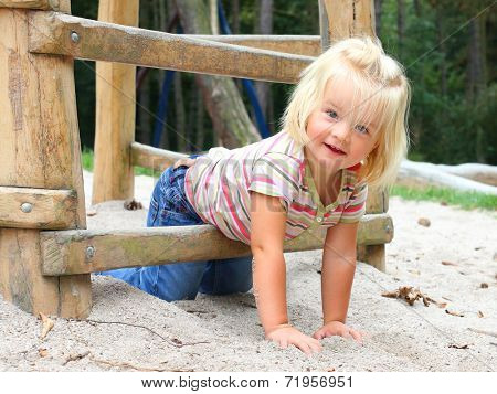 Little girl playing on a playground.