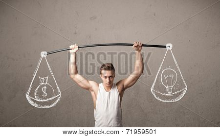 Strong muscular man trying to get balanced